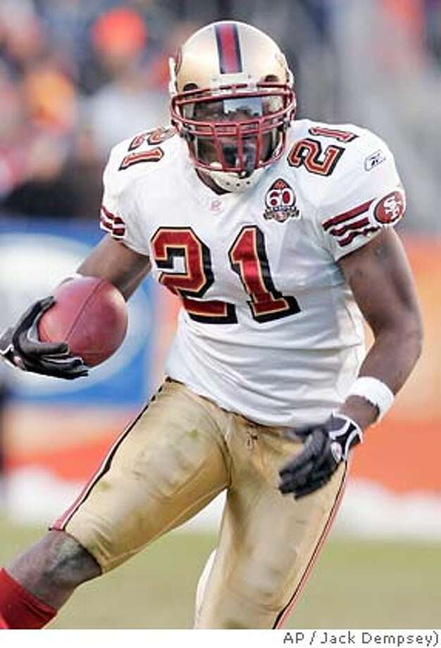 ** FILE ** San Francisco 49ers running back Frank Gore breaks through a hole for a gain against the Denver Broncos during a football game in Denver, in this Dec. 31, 2006 file photo. Gore has agreed to a four-year contract extension with the 49ers, a reward for his team-record 1,695 yards rushing last season. (AP Photo/Jack Dempsey) Photo: Jack Dempsey