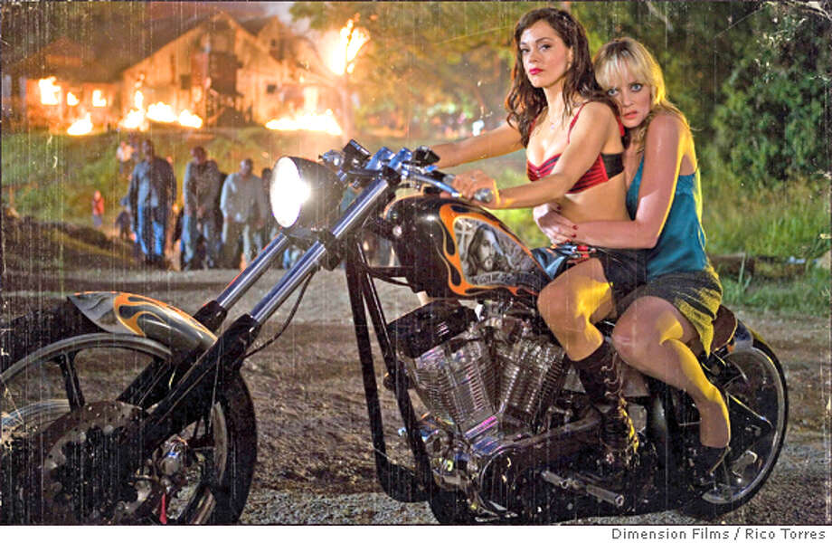 Photo Caption: Rose McGowan (Cherry)and Marley Shelton (Dakota) star in Robert Rodriquez's Planet Terror (GRINDHOUSE). Photo by: Courtesy of Dimension Films, photographer: Rico Torres.  Ran on: 04-06-2007  Rose McGowan (left) and Marley Shelton in &quo;Planet Terror,&quo; the first movie in &quo;Grindhouse.&quo; Photo: Rico Torres