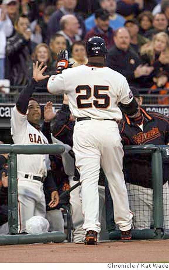 On Wednesday April 4, 2007 Barry Bonds is greeted in the dugout after hitting a homerun in the first inning and putting the first score on the board when the San Francisco Giants play the San Diego Padres on Opening Night at AT&T Park in San Francisco. Kat Wade/The Chronicle Photo: Kat Wade