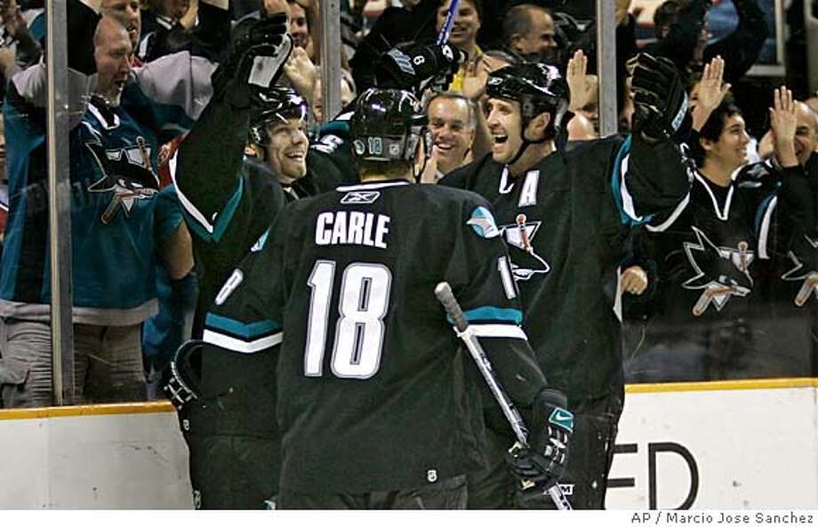 San Jose Sharks right wing Milan Michalek, left, of the Czech Republic, Matt Carle (18) and Joe Thornton celebrate Michalek's goal against the Calgary Flames in the second period of an NHL hockey game in San Jose, Calif., Thursday, April 5, 2007.(AP Photo/Marcio Jose Sanchez) Photo: Marcio Jose Sanchez