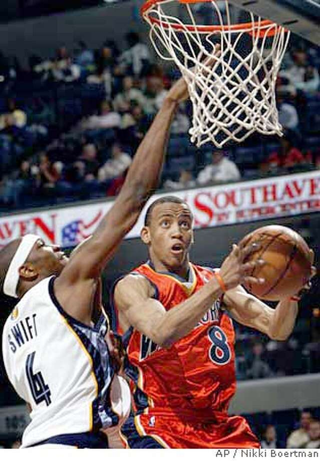 Golden State Warriors' Monta Ellis (8) slips past the defense of Memphis Grizzlies' Stromile Swift (4) during the third quarter of an NBA basketball game Friday, April 6, 2007, in Memphis, Tenn. The Warriors beat the Grizzlies, 116-104. (AP Photo/Nikki Boertman) Photo: Nikki Boertman