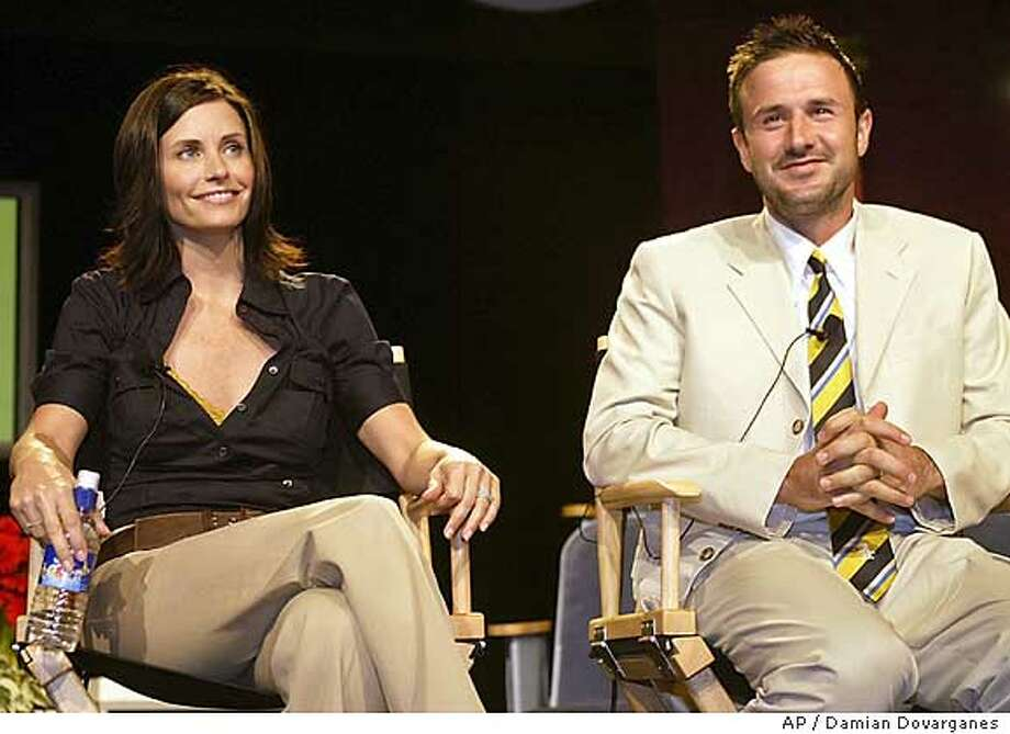 "Courteney Cox and husband David Arquette take questions from the media Tuesday, July 8, 2003, during the presentation of Women's Entertainment new show ""Mix it Up,"" at a hotel in the Hollywood area of Los Angeles. Cox and Arquette are creators and executive producers of this new home-themed series, which is inspired by their own decorating dilemmas. (AP Photo/Damian Dovarganes) Photo: DAMIAN DOVARGANES"