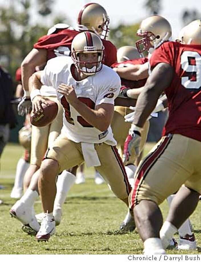49ers_460_db.jpg  San Francisco 49ers quarterback Tim Rattay runs during scrimmage on opening day of training camp at 49ers headquarters.  Event on 7/30/05 in Santa Clara.  Darryl Bush / The Chronicle MANDATORY CREDIT FOR PHOTOG AND SF CHRONICLE/ -MAGS OUT Photo: Darryl Bush