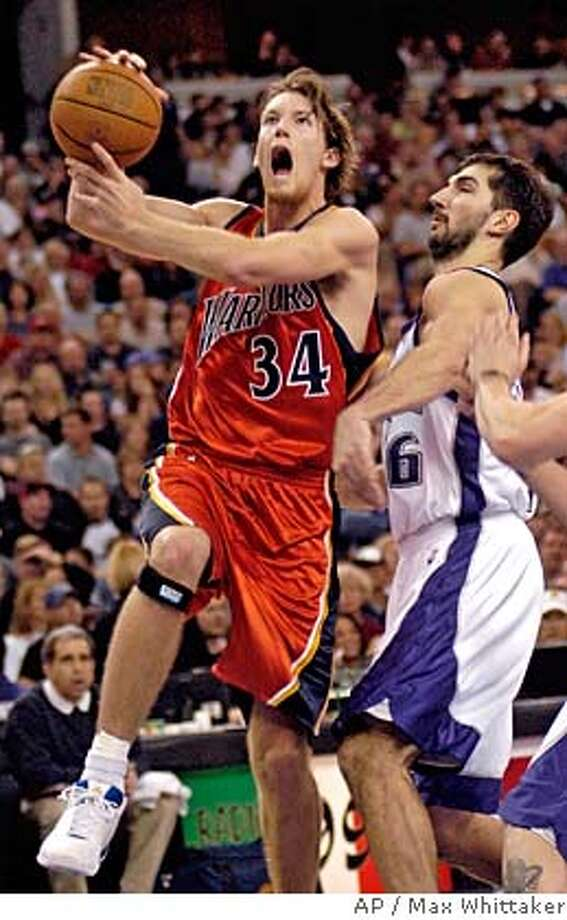 Golden State Warriors forward Mike Dunleavy drives past Sacramento Kings' Peja Stojakovic during the second quarter in Sacramento, Calif. on Sunday, March 20, 2005. (AP Photo/Max Whittaker) Ran on: 03-21-2005  A surprised-looking Mike Dunleavy drives by Sacramento's Peja Stojakovic. Ran on: 03-21-2005  A surprised-looking Mike Dunleavy drives by Sacramento's Peja Stojakovic. Photo: MAX WHITTAKER