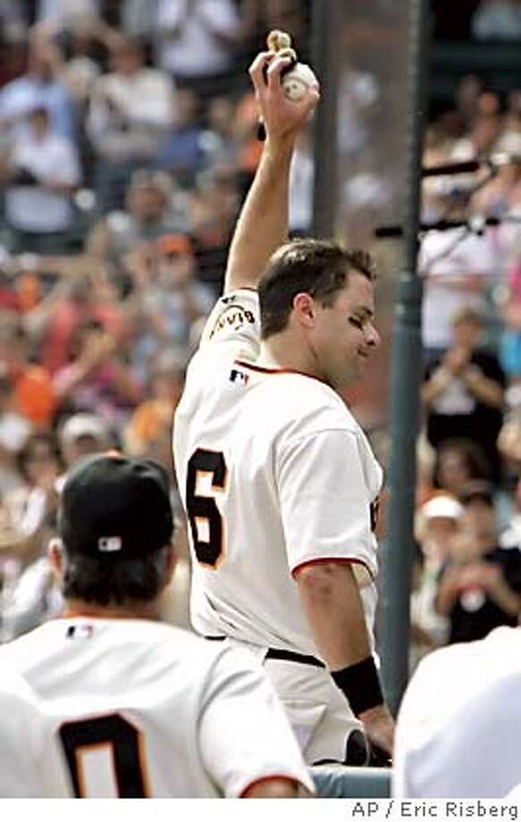 San Francisco Giants' J.T. Snow waves to the crowd after getting his 1,500th career hit against the Arizona Diamondbacks in the first inning in San Francisco, Sunday, Oct. 2, 2005. The Giants won, 3-1. (AP Photo/Eric Risberg) Photo: ERIC RISBERG