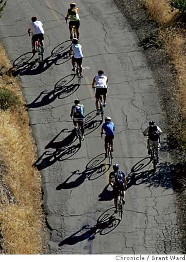diablo052_ward.jpg  As the riders emerged from the fog, the early morning sunlight cast shadows as they rode higher and higher up the mountain.  Over 1000 cyclists climbed Mount Diablo early Sunday morning in the 24th annual Mount Diablo Challenge, the largest and highest elevation cycling event in the East Bay. The cyclists climb over 3200 feet over the 10.8 mile climb through picturesque oak groves and great views.  Brant Ward 10/2/05 Photo: Brant Ward