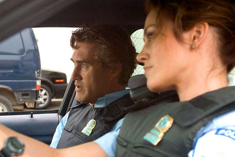 "for movies06  still from ""The Cop, the Criminal and the Clown""  Roy Dupuis, left, and Lucie Laurier Photo: SFC"