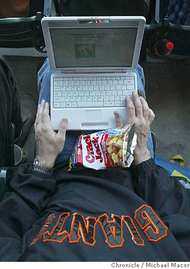 Richard Hilleman of San Mateo takes his mini-laptop to the game to follow along with the statistics and check other scores of other games. WiFi Internet access now available to fans who take in a Giants game at SBC Park here in San Francisco. event on 4/22/04 in San Francisco Michael Macor / San Francisco Chronicle Photo: Michael Macor