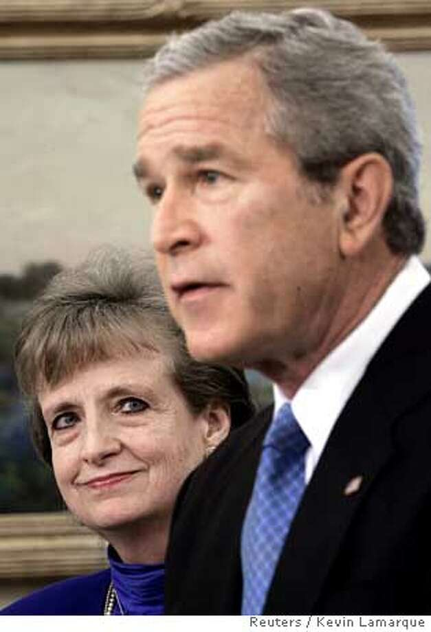 Speaking from the Oval Office of the White House in Washington, U.S. President George W. Bush announces he has picked White House counsel Harriet Miers (L) as the next justice on the U.S. Supreme , Oct 3, 2005. Miers, a longtime ally of Bush's going back to his days as Texas governor, would replace Justice Sandra Day O'Connor on the high . REUTERS/Kevin Lamarque Photo: KEVIN LAMARQUE