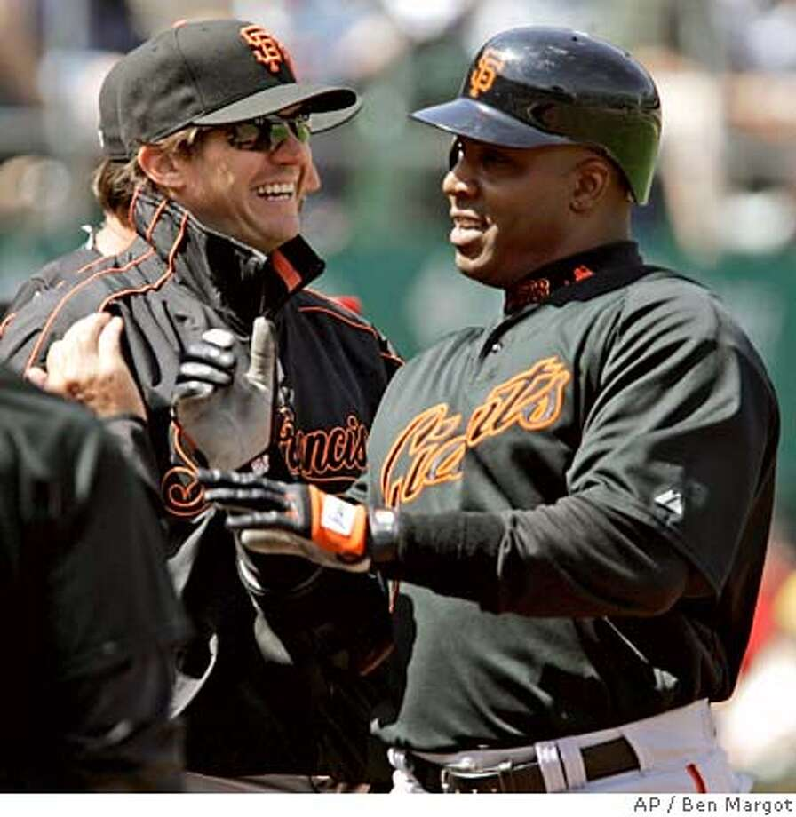 San Francisco Giants' Barry Zito, left, congratulates teammate Barry Bonds after Bonds hit his second home run off Oakland Athletics' Joe Kennedy in the third inning of an exhibition baseball game Sunday, April 1, 2007, in Oakland, Calif.(AP Photo/Ben Margot) Photo: Ben Margot