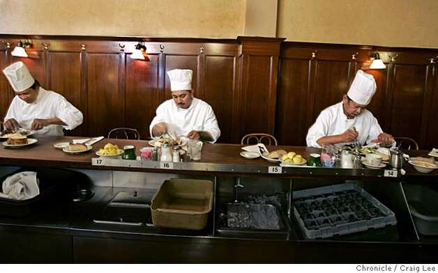 Story on Tadich Grill, 240 California Street. Photo of some of the chefs having lunch before the restaurant opens. Left-right: Adriano Dela Rosa, Jesus Rivas, and Romy Mandap. Event on 8/23/05 in San Francisco. Craig Lee / The Chronicle Photo: Craig Lee