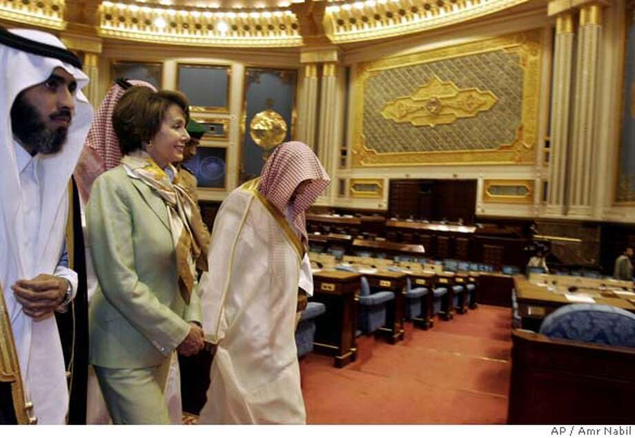 U.S. House Speaker Nancy Pelosi, center, is accompanied by Sheik Saleh bin Humaid, the head of Saudi consultative council and Imam of Mecca great mosque, right, during her visit to the Saudi council, in Riyadh, Saudi Arabia, Thursday, April 5, 2007. (AP Photo/Amr Nabil) Photo: AMR NABIL