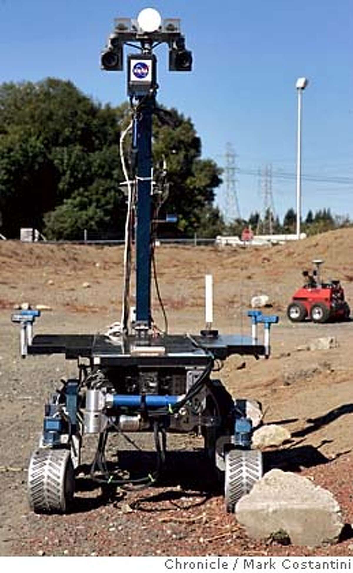 """robots04_033_mc.jpg """"K-9"""" the robot. 'Marscape' at NASA Ames Research Center, Moffett Field, Calif., Monday, Oct. 3, from 11 a.m. to 2 p.m. PDT to view prototype space robots in action. Reporters will be able to interview NASA researchers about the artificial intelligence that may some day help robots and human beings on Earth and Mars work together. Photograph by Mark Costantini/S.F. Chronicle. MANDATORY CREDIT FOR PHOTOG AND SF CHRONICLE/ -MAGS OUT"""
