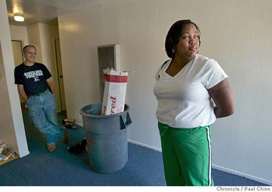 katrina01_apartments_110_pc.jpg  Jenell Walker, a former New Orleans police officer checks out her new apartment with project director Michael McDowell. Volunteers from Rebuilding Together and Affordable Housing Associates prepared eight apartments which will be occupied by displaced evacuees from Hurricane Katrina on 9/30/05 in Berkeley, Calif.  PAUL CHINN/The Chronicle MANDATORY CREDIT FOR PHOTOG AND S.F. CHRONICLE/ - MAGS OUT Photo: PAUL CHINN