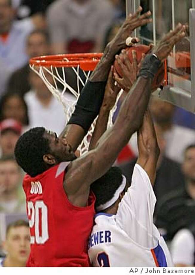Ohio State center Greg Oden (20) blocks a shot by Florida's Corey Brewer (2) during the first half of the Final Four basketball championship game at the Georgia Dome in Atlanta, Tuesday, April 2, 2007. (AP Photo/John Bazemore) Photo: John Bazemore