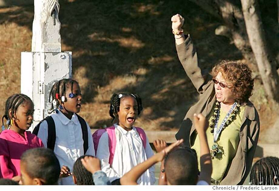 "MALCOMX_0054_fl.jpg Rosalind Sarah the principal of Malcolm X elementary school in the Harbor Points, SF., starts her day in front of the schools playyard conducting the pledge of allegiance or a morning song ""If your Happy and you Know it"" and later visits classroom, tends to meetings, and puts out small fires like bloody noses from students. She has a collection of paraphernalia from the 70's in her office from days of when she was a professional clown ""Sarah Tomato. "" 9/28/05 San Francisco CA Frederic Larson The San Francisco Chronicle Photo: Frederic Larson"