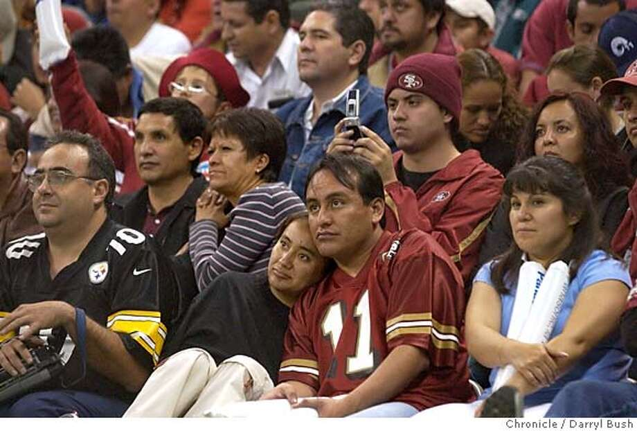 49ersMX_025_db.jpg  San Francisco 49ers fans in the crowd look dejected in the 4th qtr. after Arizona scores a TD vs. Arizona Cardinals at Azteca Stadium.  Event on 10/2/05 in Mexico City.  Darryl Bush / The Chronicle MANDATORY CREDIT FOR PHOTOG AND SF CHRONICLE/ -MAGS OUT Photo: Darryl Bush