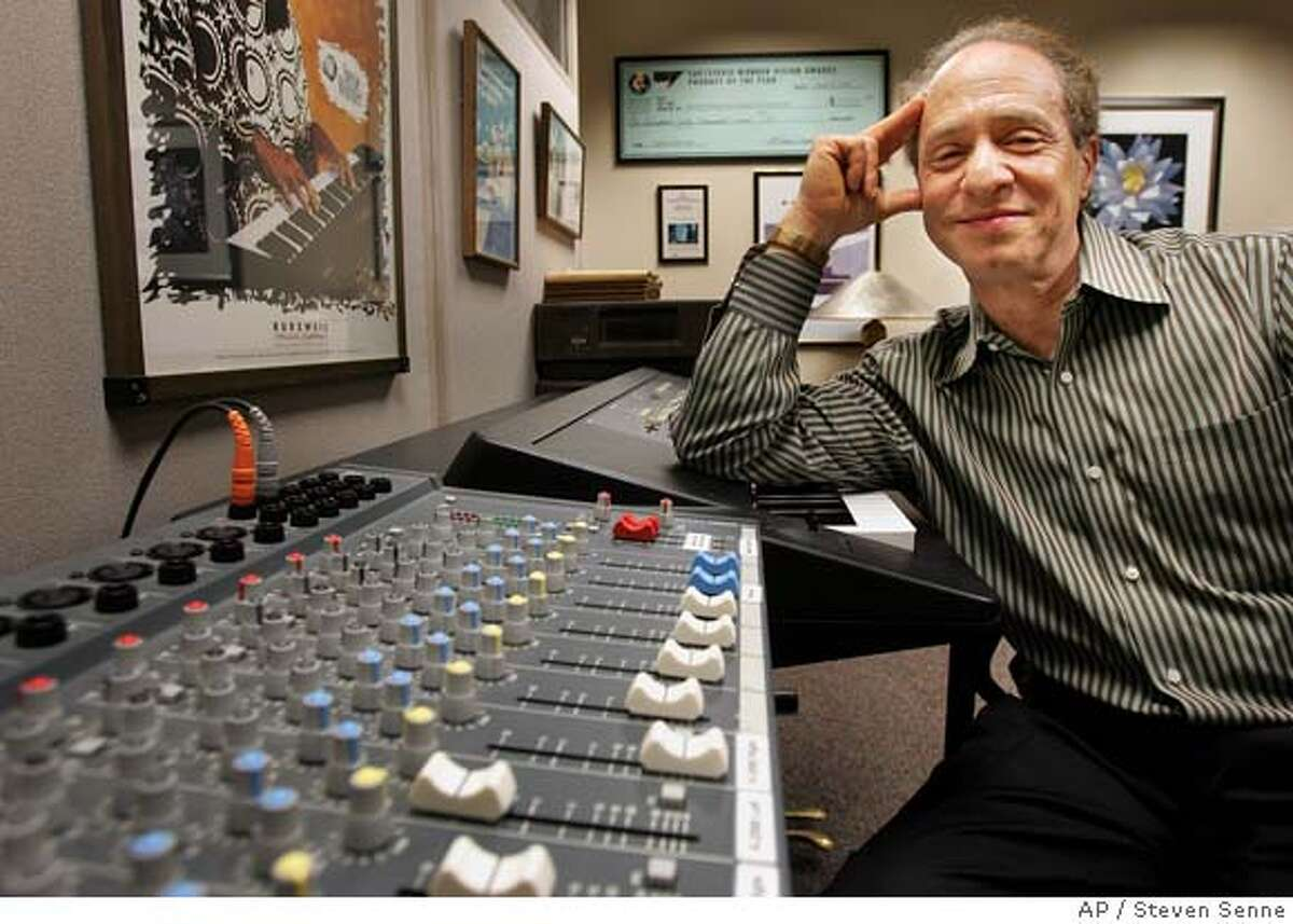 ** ADVANCE FOR SUNDAY, FEB. 13 ** Author and inventor Ray Kurzweil, 56, sits in front of a music mixing board in his office, in Wellesley, Mass., Jan. 12, 2005. Kurzweil is serious about his health because if it fails him, he might not live long enough to see humanity achieve immortality, a seismic development he predicts is possible in his new book;