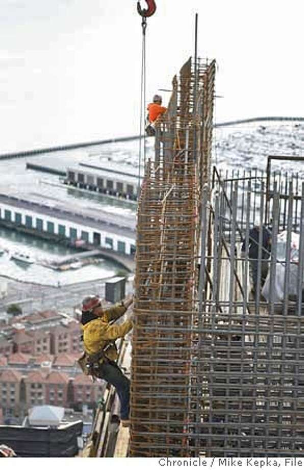 rincon00434_mk.JPG  Construction workers scale sets of rebar on the highest completed floor at Rincon towers in San Francisco near 1st and Harrison Streets. 2/28/07.  Mike Kepka / The Chronicle Ran on: 03-02-2007  Vincente Roman, project engineer for Bovis Lend Lease, the contractor, walks along the top of the giant crane used on One Rincon Hill in San Francisco.  Ran on: 03-02-2007  Vincente Roman, project engineer for Bovis Lend Lease, the contractor, walks along the top of the giant crane used on One Rincon Hill in San Francisco.  Ran on: 03-02-2007  Vincente Roman, project engineer for Bovis Lend Lease, the contractor, walks along the top of the giant crane used on One Rincon Hill in San Francisco. MANDATORY CREDIT FOR PHOTOG AND SF CHRONICLE/NO SALES-MAGS OUT Photo: Mike Kepka