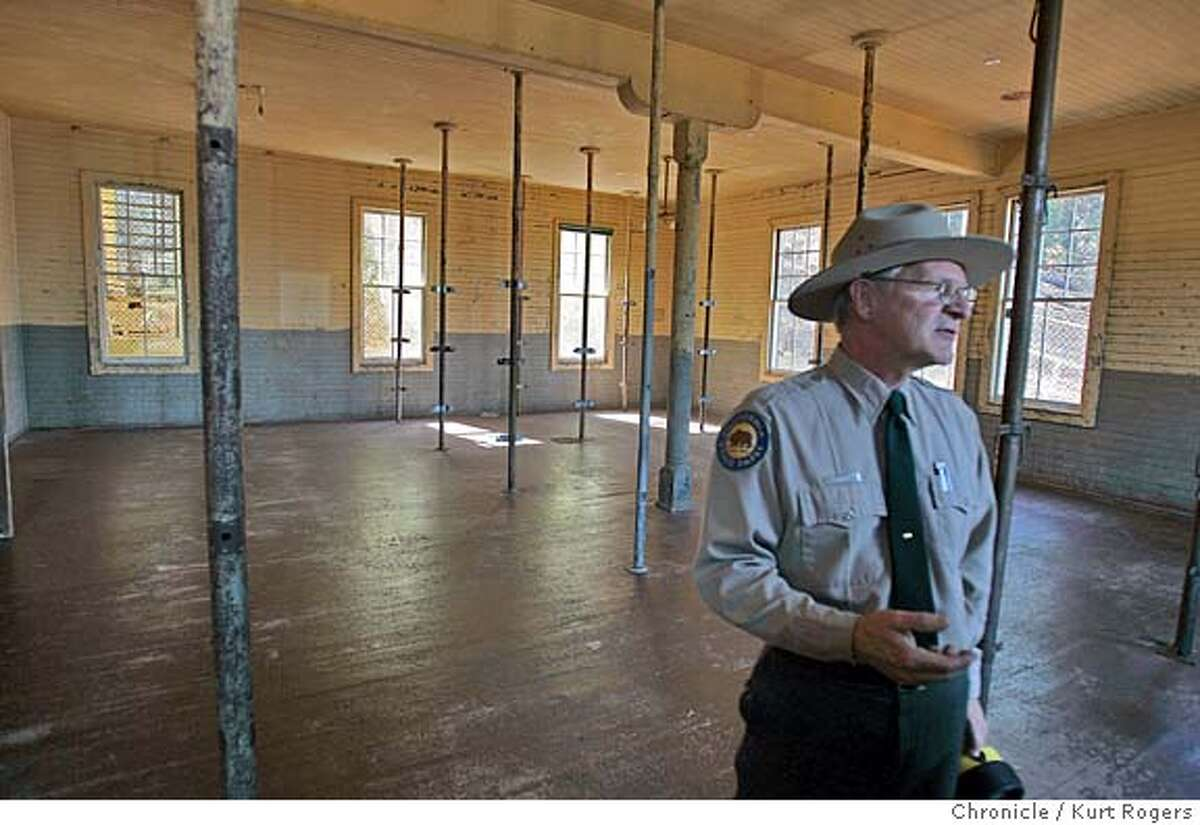 Roy McNamee the park superintendent stands in what was the the bunk house for women.The polls are where the bunks were . A $50 million program to preserve the historic Immigration Station on Angel Island, or what has been called the Ellis Island of the West. The first phase of the work focuses on protecting the famous poems etched into the barrack walls nearly 100 years ago by Chinese immigrants. ANGELISLAND27_0084_kr.JPG 9/27/05 in TIBURON,CA. KURT ROGERS/THE CHRONICLE MANDATORY CREDIT FOR PHOTOG AND SF CHRONICLE/ -MAGS OUT
