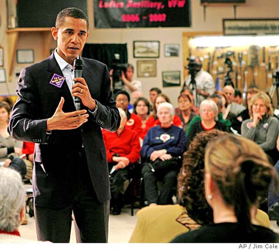 Democratic presidential hopeful U.S. Sen. Barack Obama talks to a crowd at the VFW during a campaign stop in Rochester, N.H., Tuesday, April 3, 2007. (AP Photo/Jim Cole) Photo: Jim Cole
