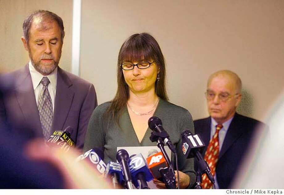 With attorney Jim Brosnahan to the their right, John Walker Lindh's parents Frank Lindh and Marilyn Walker speak during a press conference in downtown San Francisco pleading for Lindh's early release. Photo taken in San Francisco on 4/4/07.  MIKE KEPKA / The Chronicle Jim Brosnahan Frank Lindh Marilyn Walker (cq) the source Photo: MIKE KEPKA