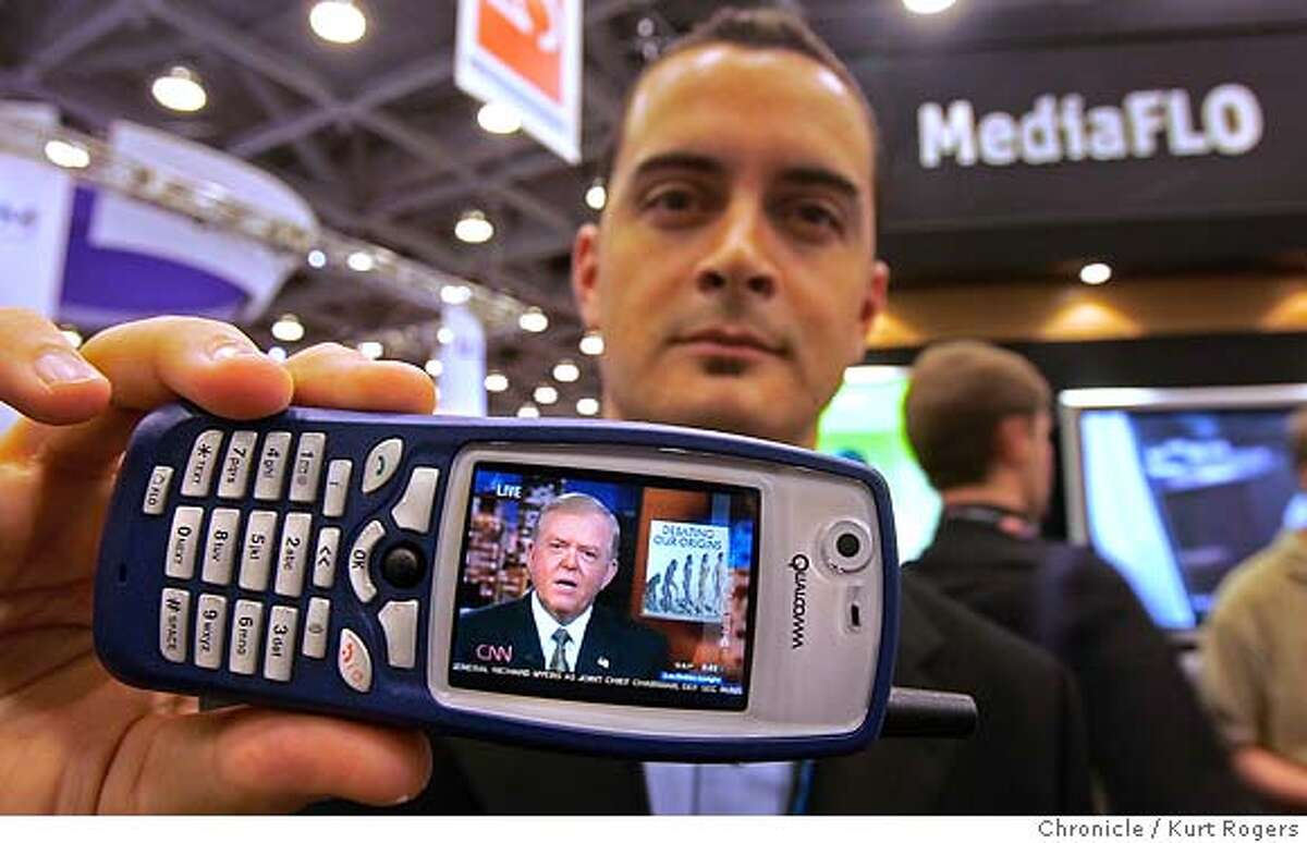 Daniel Berthiaume with Qualcomm shows off there new technology MediaFLO video on phones. CTIA WIRELESS IT & Entertainment 2005 convention is here. more than 15,000 wireless and cell phone people will talk about the latest and greatest in cell . phones and mobile entertainment. CTIA29_0018_kr.JPG 9/28/05 in San Francisco,CA. KURT ROGERS/THE CHRONICLE MANDATORY CREDIT FOR PHOTOG AND SF CHRONICLE/ -MAGS OUT