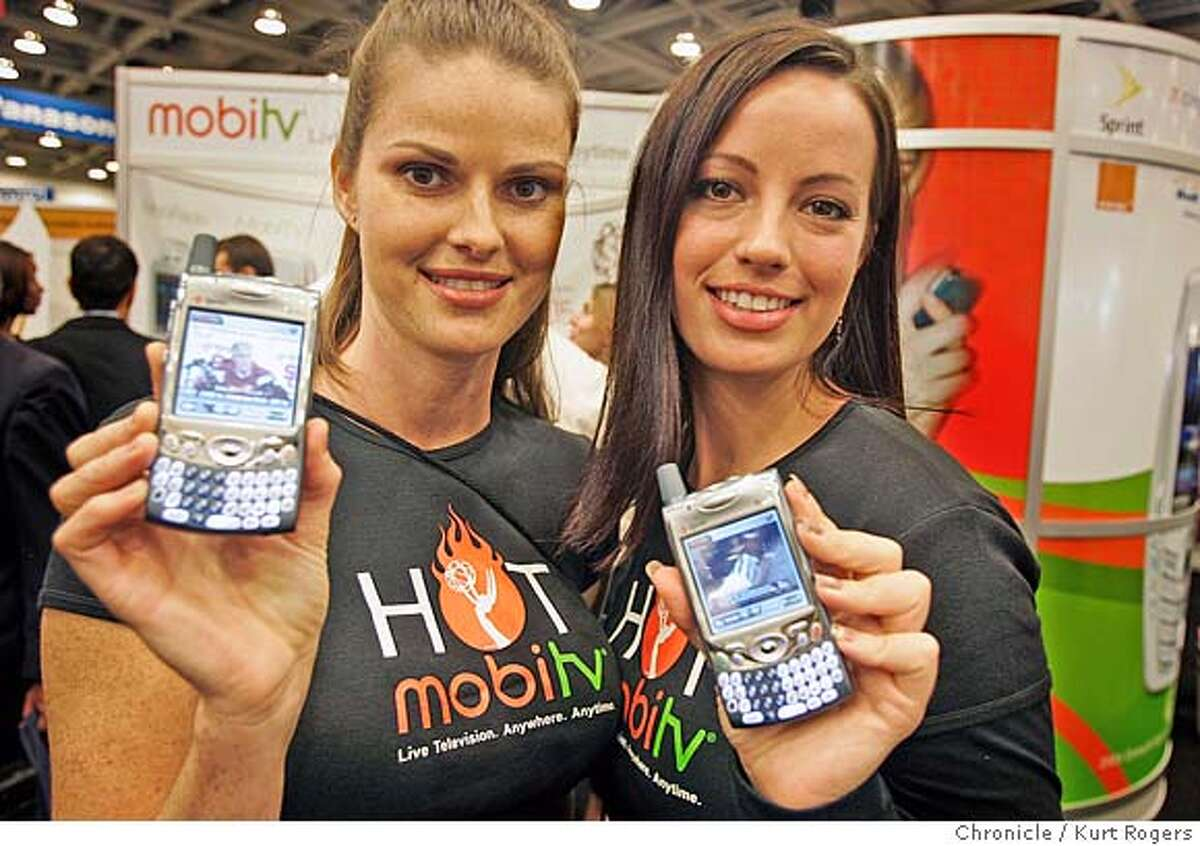 Models for MobiTV Hope Johnson and Anna Curtis show off the new Live Television anywhere anytime mobile phone. CTIA WIRELESS IT & Entertainment 2005 convention is here. more than 15,000 wireless and cell phone people will talk about the latest and greatest in cell . phones and mobile entertainment. CTIA29_0059_kr.JPG 9/28/05 in San Francisco,CA. KURT ROGERS/THE CHRONICLE MANDATORY CREDIT FOR PHOTOG AND SF CHRONICLE/ -MAGS OUT