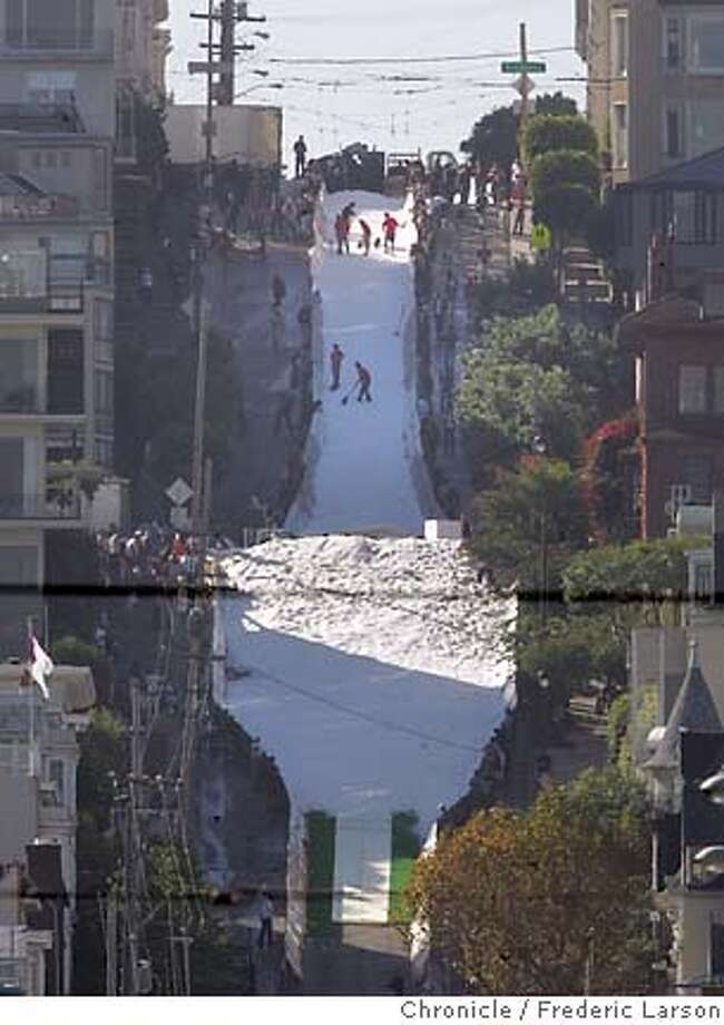 SKIJUMP13_0594_fl.jpg 10am -photo's of progress every 15 minutes from the foot of Filmore Street and Marina- Icer Air 2005, a promotional ski-jump contest took over an intersection of San Francisco's Fillmore Street and surrounding blocks in Pacific Heights Wednesday afternoon. And residents who live near the section of the Fillmore Street hill where the jumpers will be flying Thursday -- and who objected to the issuing of city permits for the event because of the disruption it would cause and financial risk the city would face -- are angrier than before. Snow blowing begins at 7am; practice at 10am; the Jumps happen from noon to 4pm...ry  Photographer:� 9/29/05 San Francisco CA Frederic Larson The San Francisco Chronicle Photo: Frederic Larson