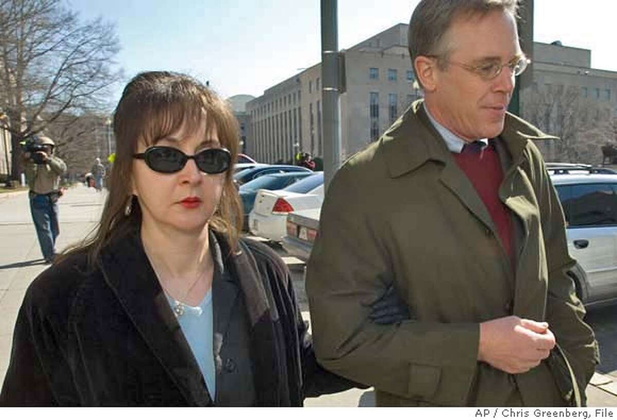 Deborah Jean Palfrey of Vallejo, Calif., left, and her attorney Montgomery Blair Sibley, leave the federal court in Washington, Friday, March 9, 2007 after Palfrey's arraignment on federal racketeering charges, Friday March 9, 2007 in Washington. (AP Photo/Chris Greenberg)