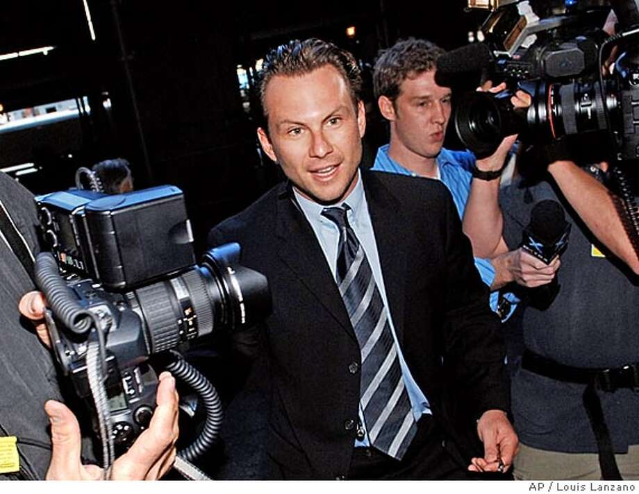 Actor Christian Slater enters Manhattan criminal court, Monday, Sept. 2005, in New York. Slater is facing charges of forcible touching -- a misdemeanor that carries up to one year in jail -- after he allegedly walked up behind a woman and grabbed her buttocks as she was buying a soda in a small grocery store on Manhattan's Upper East Side in the early morning of May 31.(AP Photo/ Louis Lanzano) Photo: LOUIS LANZANO