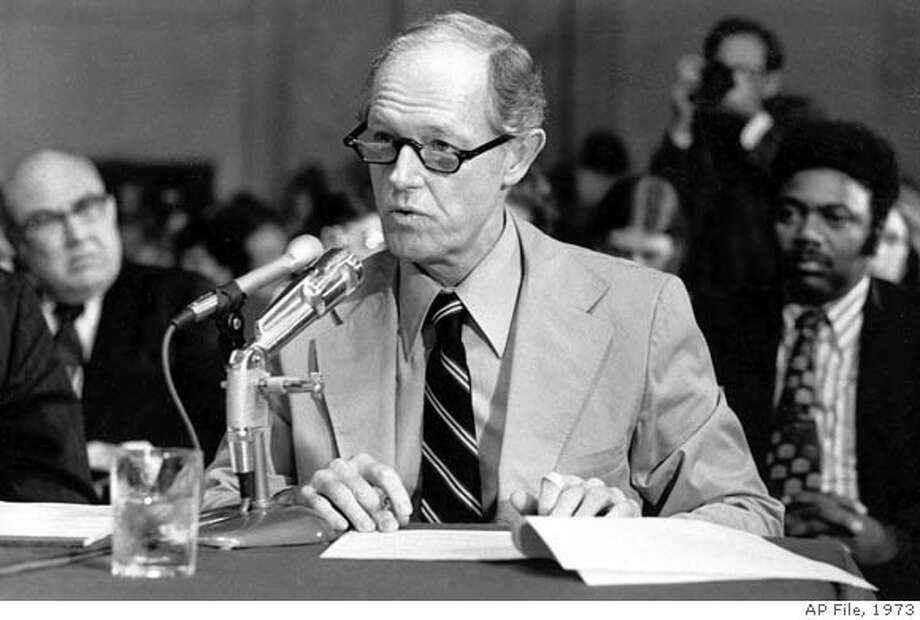 ** FILE ** E. Howard Hunt responds to a question from the counsel for the Senate Watergate Committee in Washington, D.C., in this Sept. 24, 1973 file photo. Hunt, who helped organize the Watergate break-in that led to the greatest scandal in American political history and the downfall of Richard Nixon's presidency, died Tuesday, Jan 23, 2007. He was 88. (AP Photo)