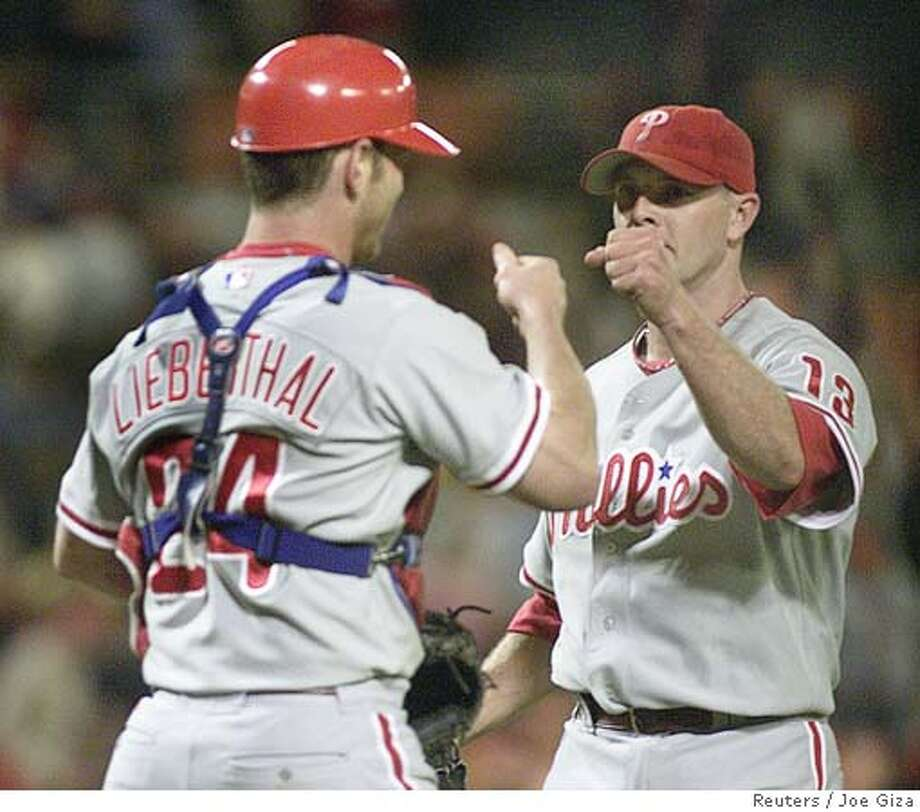 Philadelphia Phillies relief pitcher Billy Wagner (R) is greeted by catcher Mike Lieberthal after the Phillies defeated the Washington Nationals 4-3 at RFK Stadium in Washington, D.C. September 30, 2005. Wagner recorded the save in the win which moved the Phillies to within one game of the Houston Astros for the wild card spot in the National League. REUTERS/Joe Giza 0 Photo: JOE GIZA