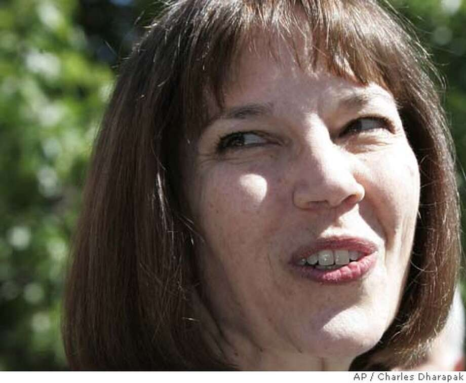 New York Times reporter Judith Miller speaks to reporters outside the courthouse in Washington D.C. Friday, Sept. 30, 2005. Miller testified before a grand jury Friday, ending her silence in the investigation into whether White House officials leaked the name of a covert CIA operative, Valerie Plame. (AP Photo/Charles Dharapak) Photo: CHARLES DHARAPAK
