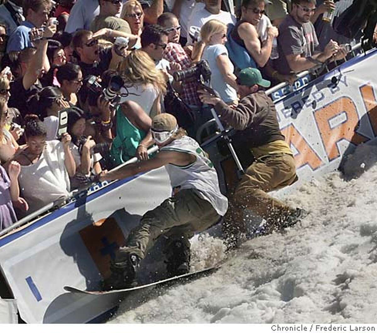 SKIJUMP_0643_fl.jpg Too close for comfort as many trick jump skier hit the wall on Filmore Street in SF. Thousands of people converged late this morning on a hillside intersection of San Francisco's elite Pacific Heights neighborhood where contractors put the finishing touches on a 2-block run of snow and a ramp for a promotional ski-jump competition. Bathed in warm sunlight that was pushing temperatures into the upper 70s, onlookers arrived in tank-tops, shorts and sandals, carrying picnic lunches and with their dogs in tow. Some of the attire suggested employees were ducking out of work. And some of the assembled were youngsters who apparently got a pass from attending school today -- at least to get a glimpse of Icer Air 2005. 9/30/05 San Francisco CA Frederic Larson The San Francisco Chronicle