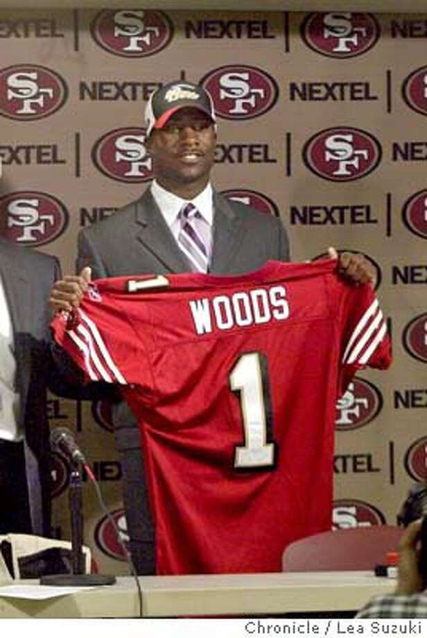 San Francisco 49ers coach Dennis Erickson, center, is flanked by draft picks Justin Smiley of Alabama, left, and Rashaun Woods of Oklahoma, Sunday, April 25, 2004, during a news conference at 49ers headquarters in Santa Clara, Calif. (AP Photo/The San Francisco Chronicle, Lea Suzuki) Ran on: 07-29-2004  Coach Dennis Erickson (center) will enter training camp without Justin Smiley (left) and Rashaun Woods in the fold. Ran on: 07-29-2004  Coach Dennis Erickson (center) will enter training camp without Justin Smiley (left) and Rashaun Woods in the fold. ALSO Ran on: 08-17-2005  Rashaun Woods is injured for the second training camp since the 49ers picked him in 2004. MANDATORY CREDIT FOR PHOTOG AND SF CHRONICLE, , MAGS OUT Photo: LEA SUZUKI