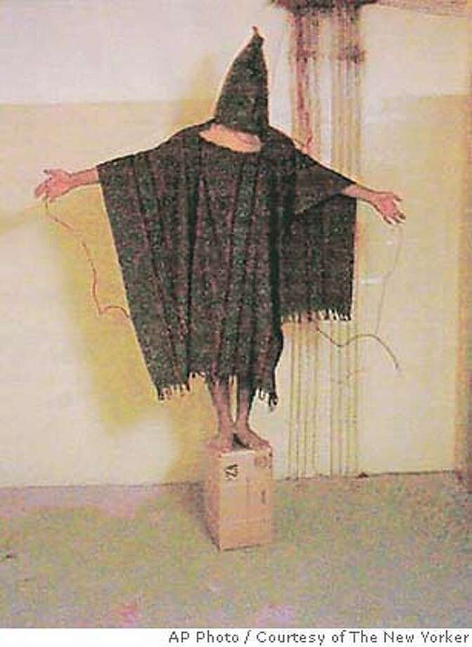 � ** FILE ** In this undated file photo released by the New Yorker, a hooded and wired Iraqi prisoner is seen at the Abu Ghraib prison near Baghdad, Iraq. The New York Times is investigating questions raised about the identity of a man who said in a Page 1 profile that he is the Abu Ghraib prisoner whose hooded image became an icon of abuse by American captors. (AP Photo/Courtesy of The New Yorker, File, HO)Ran on: 03-19-2006 Prisoner abuse at Abu Ghraib prison near Baghdad is a symptom of U.S. moral malaise. NO SALES, UNDATED HANDOUT FILE PHOTO, MANDATORY CREDIT Photo: AP