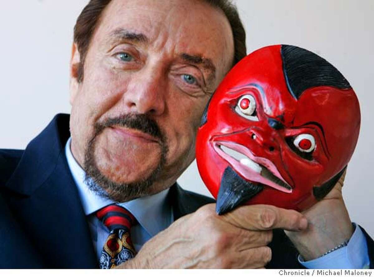 Philip Zimbardo collects masks from all over the world. He holds one of them, a devil mask from Bali. Photo taken on March 23, 2007 at Zimbardo's San Francisco home. San Francico author and social psychologist Philip Zimbardo is the author of