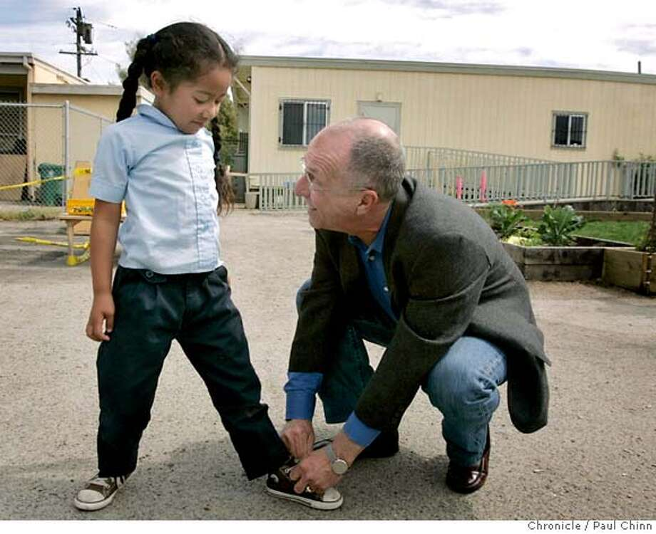 David Rosenthal, chairman of the Richmond Children's Foundation, ties shoelaces for Meletoto Misi at the Richmond College Preparatory school in Richmond, Calif. on Thursday, March 22, 2007. Rosenthal, a civil rights lawyer, started the foundation that funds Richmond Prep with proceeds from a settlement following a General Chemical explosion in 1993 and said the school�s goal is to transform the neighborhood through its youngest, most vulnerable residents.  PAUL CHINN/The Chronicle  **David Rosenthal, Meletoto Misi MANDATORY CREDIT FOR PHOTOGRAPHER AND S.F. CHRONICLE/NO SALES - MAGS OUT Photo: PAUL CHINN
