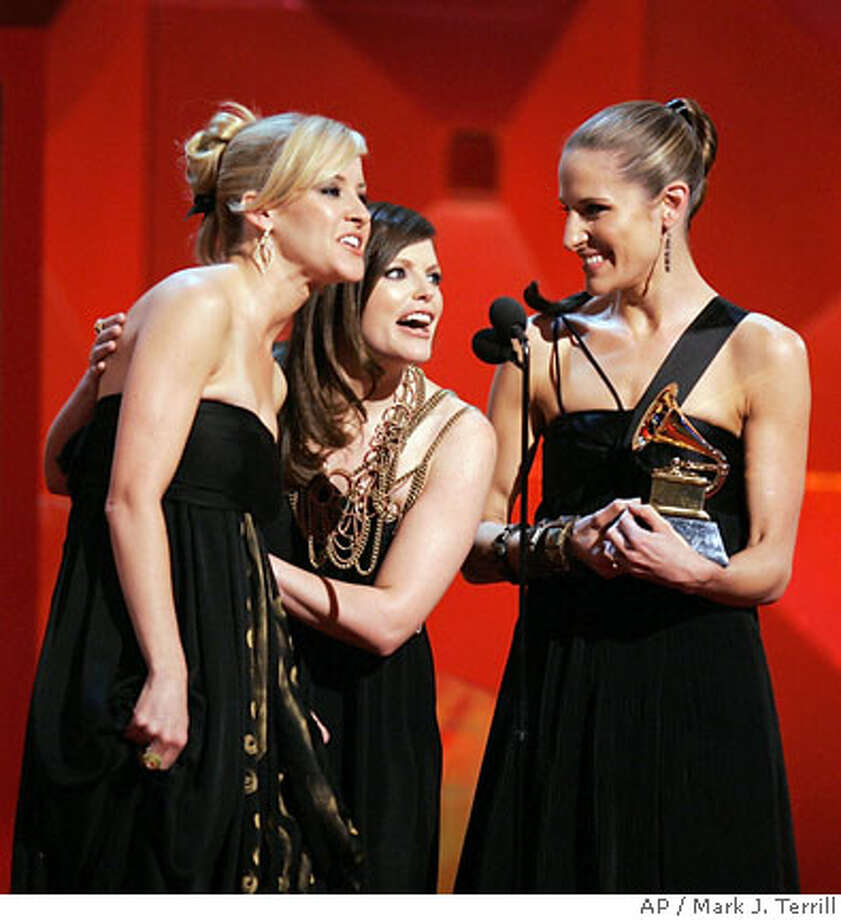 """The Dixie Chicks from left, Martie Maguire, Natalie Maines, and Emily Robison, accept the award for best country album for """"Taking the Long Way"""" at the 49th Annual Grammy Awards on Sunday, Feb. 11, 2007, at the Staples Center in Los Angeles. (AP Photo/Mark J. Terrill)  Ran on: 02-12-2007 Photo: Mark J. Terrill"""