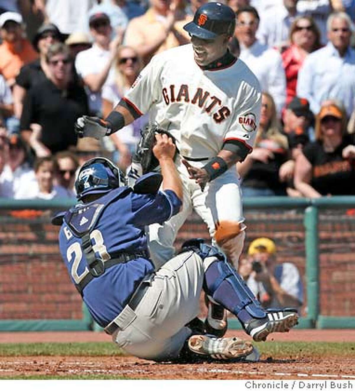 Barry Bonds is tagged out at home in the bottom of the first inning while trying to score off of a wild throw to first base. 2007 Giants Opening Day at AT&T Park Street in San Francisco on Tuesday, April 03, 2007. photo taken: 04/03/07 Darryl Bush / The Chronicle ** Barry Bonds (roster cq)
