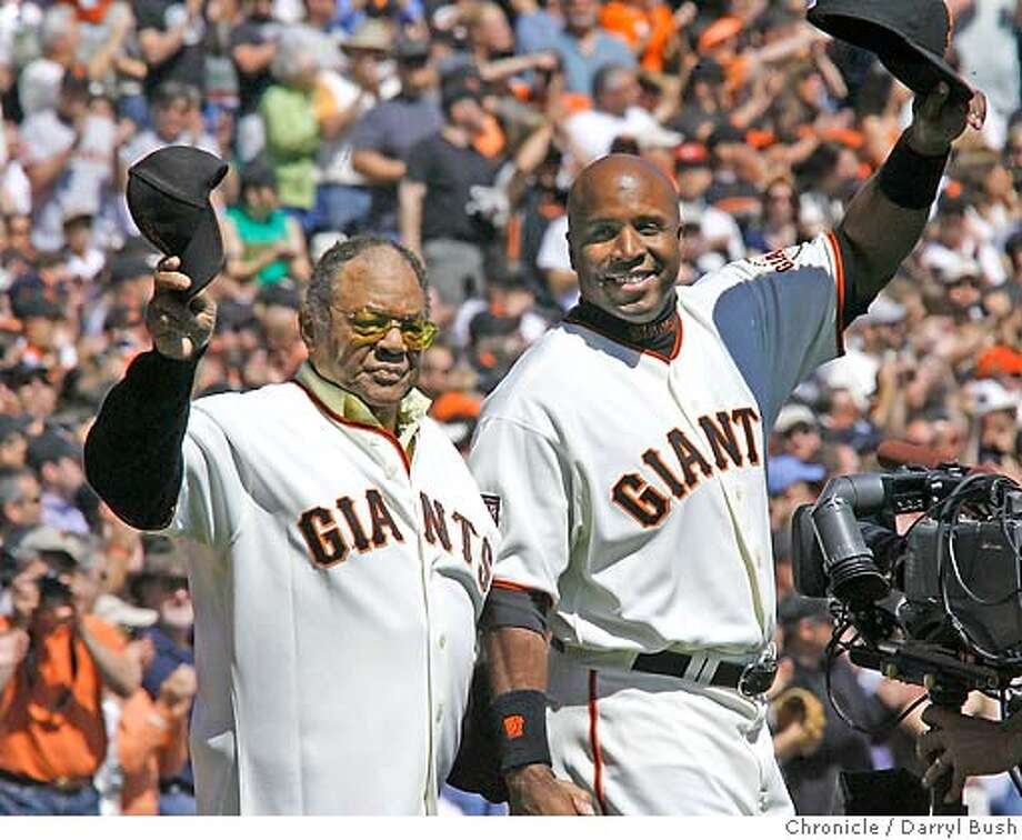 Barry Bonds and his godfather Willie Mays take the field together during the All-Star Salute. 2007 Giants Opening Day at AT&T Park Street in San Francisco on Tuesday, April 03, 2007. photo taken: 04/03/07 Darryl Bush / The Chronicle ** (roster cq) Photo: Darryl Bush