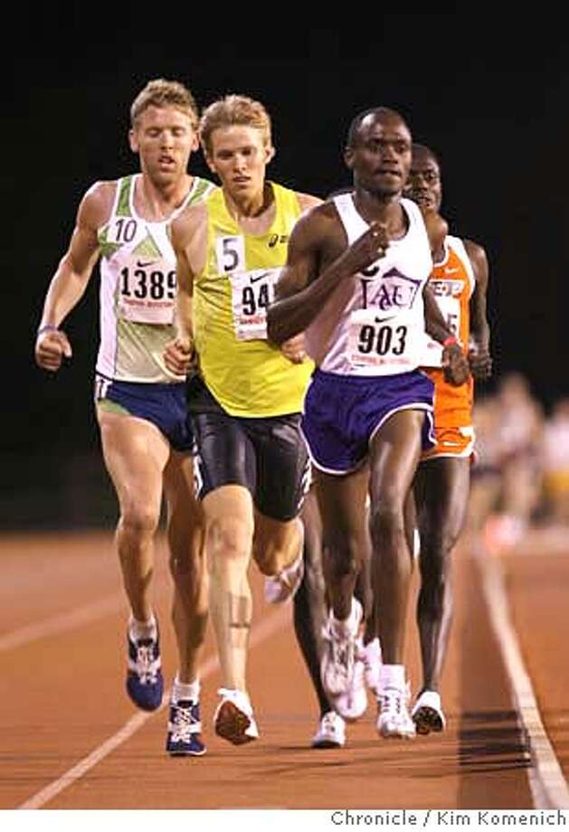 TRACK01_402_KK.JPG  Nicodemus Naimadu (903) makes the move in the last lap to pull ahead of Ryan Hall (5) and Jason Hartmann (10) and Stephen Samoei (behind)Naimadu at the Stanford Invitational Track and Field Meet at Cobb Track Saturday. The finish was Nicodemus Naimado 28:06;26, followed by Stephan Samoei, Ryan Hall and Jason Hatrmann. Photo by Kim Komenich/The Chronicle Photo: Kim Komenich