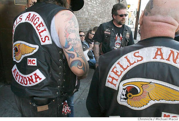 Members gather in front of the club. The Hell's Angels Motorcycle Club celebrates the 50th anniversary of the founding of the Oakland Chapter back in 1957. Members from all over the world arrive to join the celebration beginning at the historic club on Foothill Blvd. in Oakland. Photographed in, Oakland, Ca, on 3/30/07. Photo by: Michael Macor/ The Chronicle Photo: Michael Macor