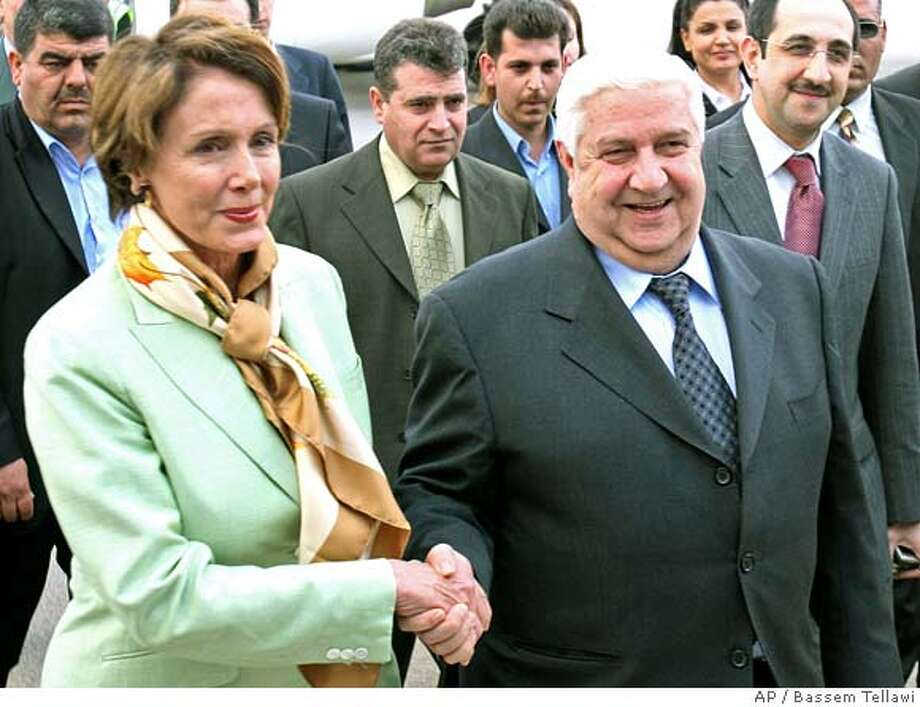 Syrian Foreign Minister Walid Moallem, right, welcomes U.S. House speaker Nancy Pelosi, at Damascus International Airport, Tuesday April 3, 2007. Pelosi arrived in Damascus as the highest ranking U.S., official to visit Syria since 2003, for talks with the Syrian leadership on ways of reviving relations and building confidence between both countries. .(AP Photo/ Bassem Tellawi). Photo: BASSEM TELLAWI