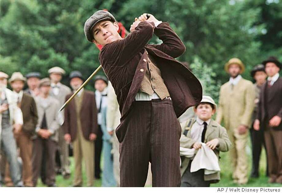 "In this photo provided by Walt Disney Pictures, An amateur player from a working class family, Francis Ouimet (Shia LaBeouf) shocked the golf world when at the 1913 U.S. Open he defeated his idol, in ""The Greatest Game Ever Played."" (AP Photo/Walt Disney Pictures) Photo: Walt Disney Pictures"