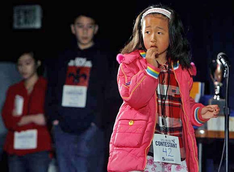 """Second grader Jenny Jin, from Lafayette Elementary School in San Francisco, was stumped by the word """"Nostradamus"""" at the Chronicle Spelling Bee in San Francisco, Calif. on Saturday, March 24, 2007. The winner advances to the national finals in Washington D.C. in May.  PAUL CHINN/The Chronicle  **Jenny Jin Photo: PAUL CHINN"""