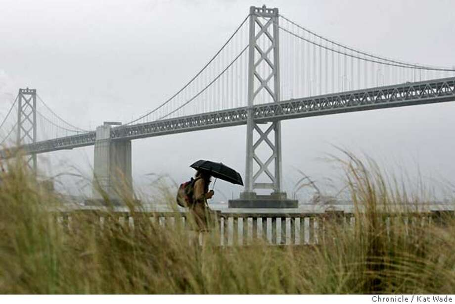 RAINart_009_KW.jpg  Gray sky and rain over the Bay Bridge foretells the coming lighting and thunder storms expected Monday evening in San Francisco on Monday March 26, 2007.  Kat Wade/The Chronicle Mandatory Credit for San Francisco Chronicle and photographer, Kat Wade, No Sales Mags out Photo: Kat Wade
