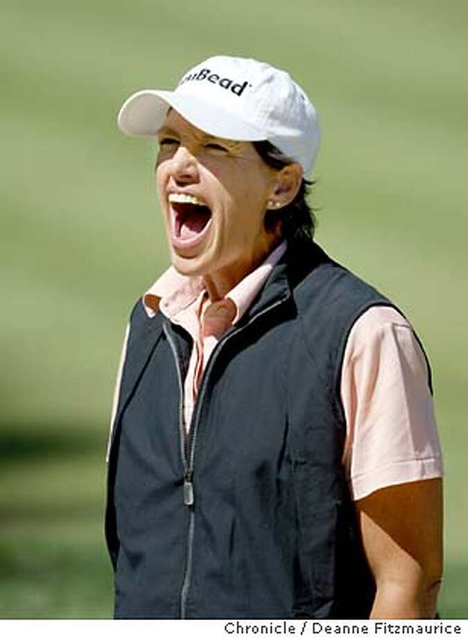 Juli Inkster makes a big smiley face to her caddies' infant daughter who she spotted in the stands along the 18th hole. She is playing in the practice rounds of the 2003 U.S. Women's Open Championship before the tournament in North Plains, Oregon. Shot on 7/2/03 in North Plains. DEANNE FITZMAURICE / The Chronicle Photo: DEANNE FITZMAURICE