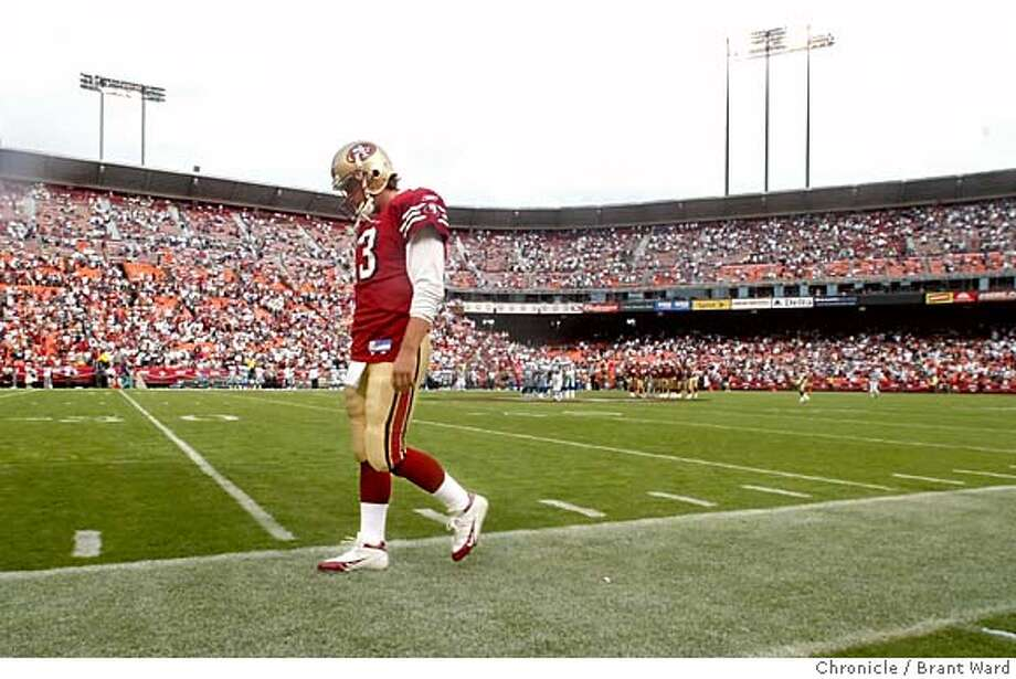 A dejected Tim Rattay walked the sidelines in silence after his interception ended the 49ers chances.  San Francisco 49ers vs Dallas Cowboys at Monster Park. The 49ers lost in the closing minutes 34-31.  Brant Ward 9/25/05 Photo: Brant Ward